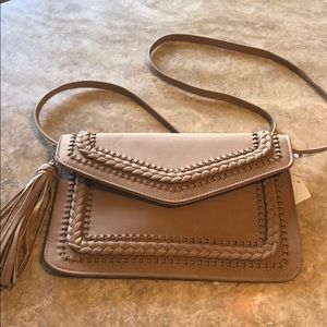 Handbags - New with tags. Faux leather crossbody